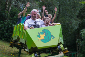 Man and child on rollercoaster