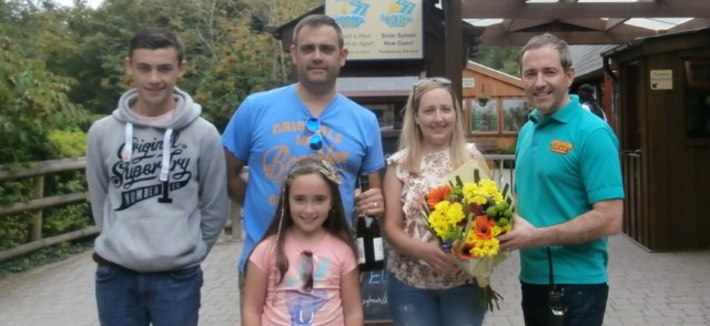 Family receiving presents for being 2 millionth visitor to the Park